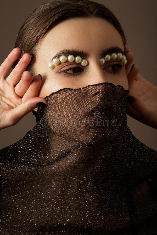 Kvinnlig id?rik makeup arkivfoto