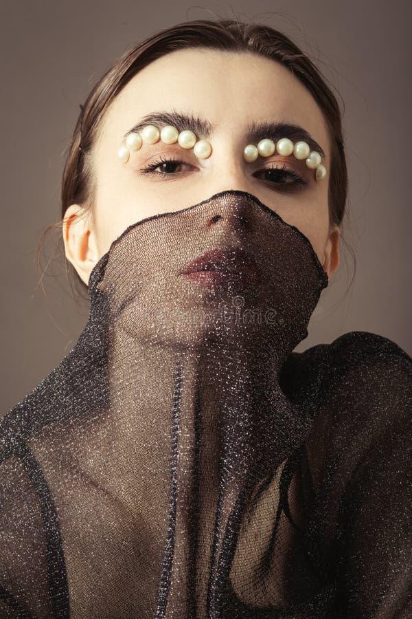Kvinnlig id?rik makeup arkivbild