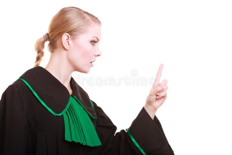 Kvinnlig kappa för advokatklassikerpolermedel som viftar hennes gräla på för finger royaltyfria foton