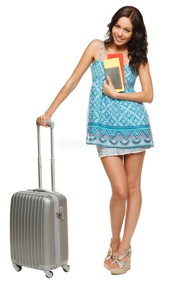 Kvinnlig med resväska och jobbanvisningar arkivfoto