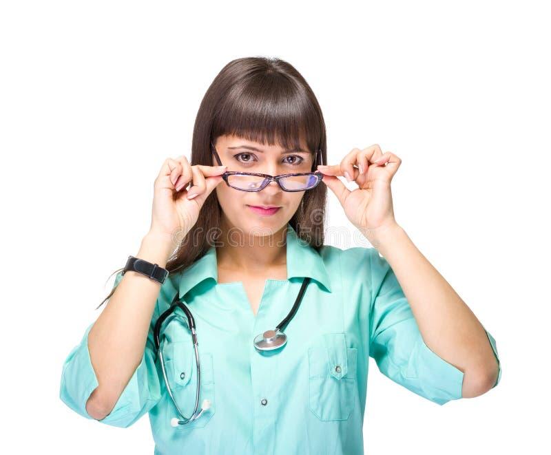 Kvinnlig medicinsk doktor med isolerade exponeringsglas arkivbilder