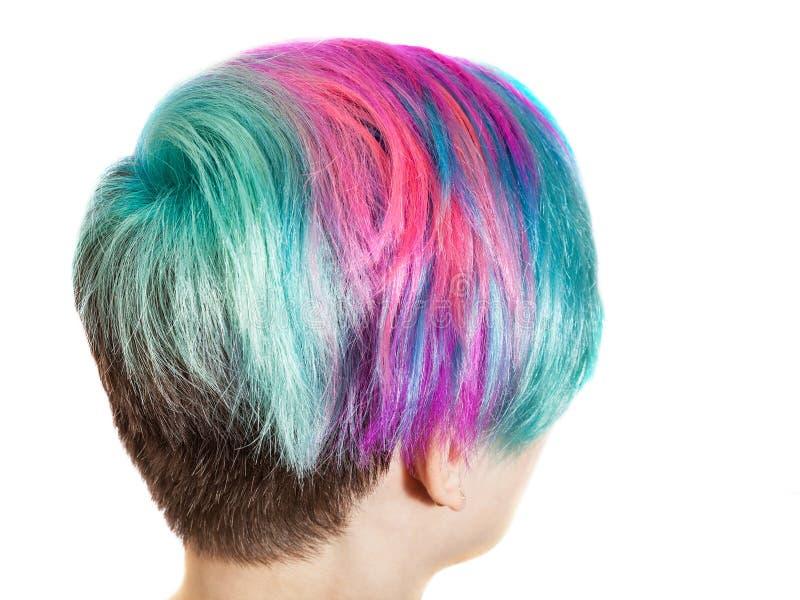 Kvinnlig nacke med mång- kulöra färgade hår royaltyfria foton