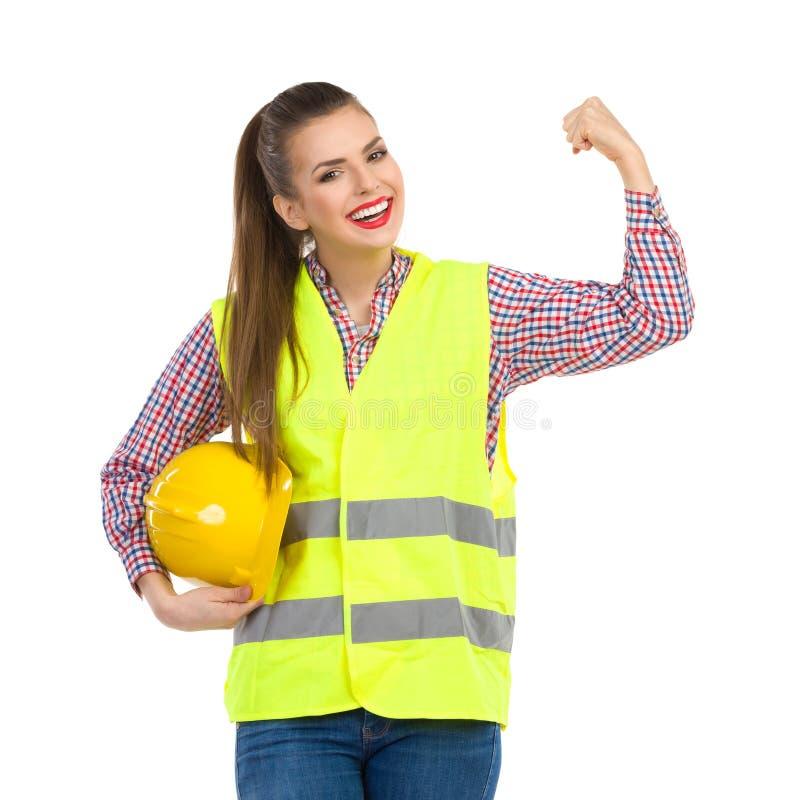 Kvinnlig resningnäve för manuell arbetare arkivbild