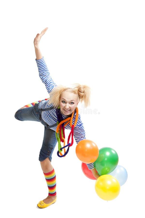 Kvinnlig rolig clown med ballonger arkivbild