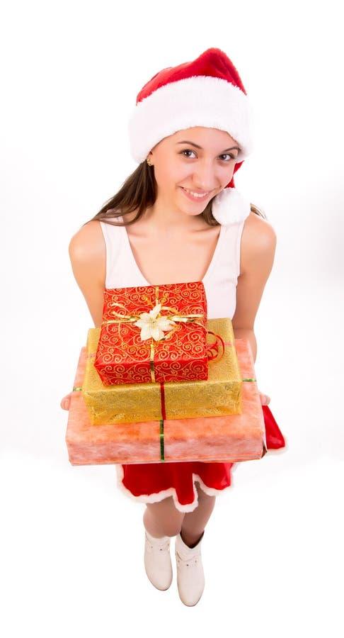 Kvinnlig Santa med gåvaaskar. arkivfoto