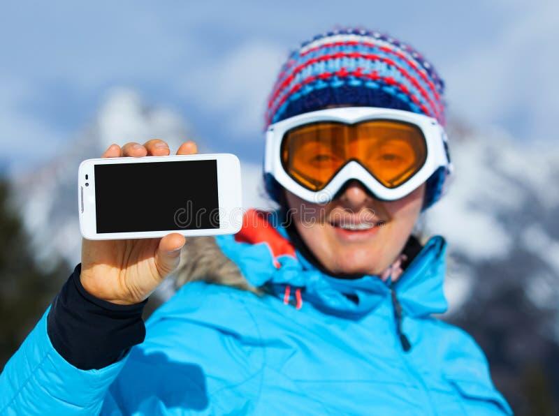 Kvinnlig skidåkare royaltyfri fotografi