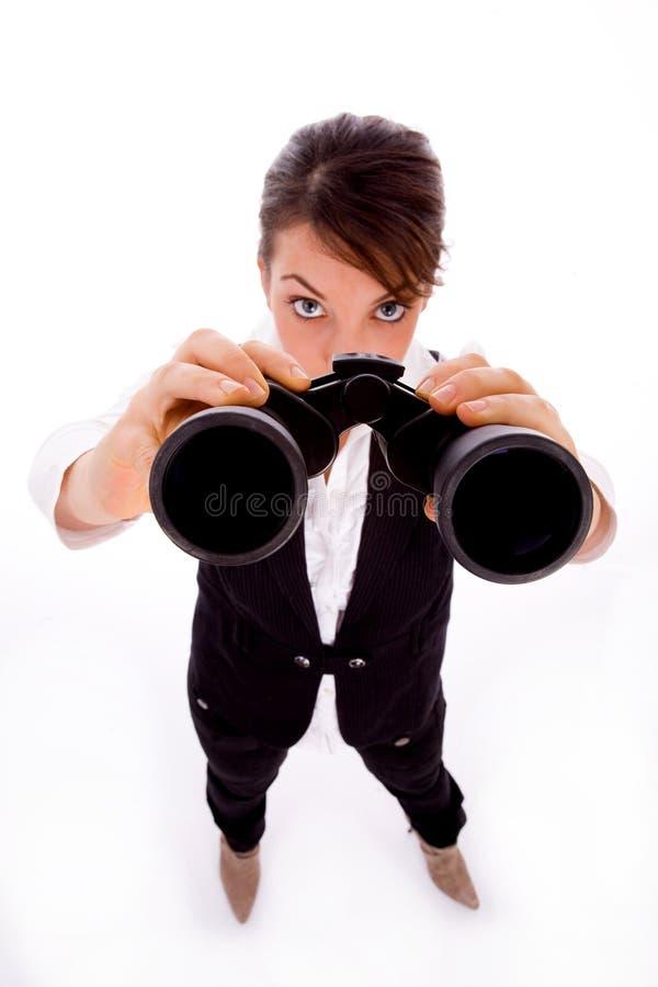 kvinnlig som ser övre sikt för sida arkivfoto