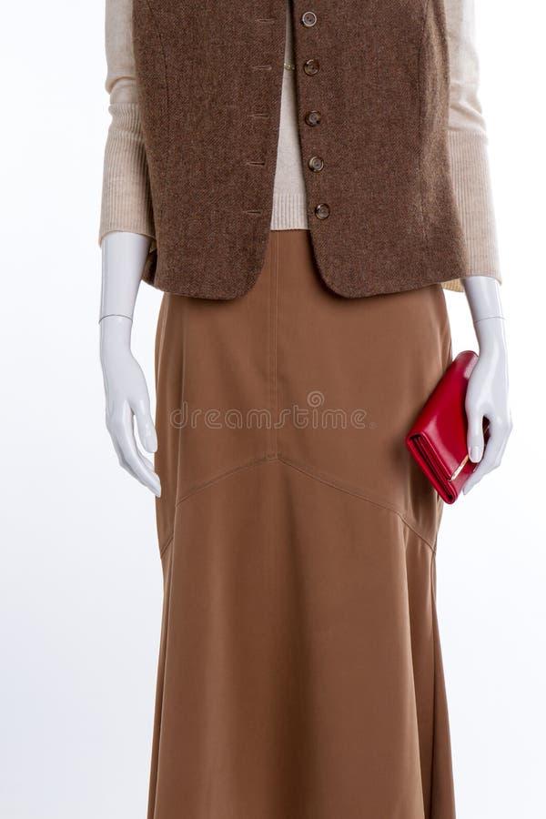 Kvinnlig waistcoat, kjol och plånbok arkivfoto