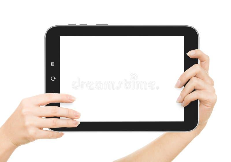 Kvinnliga händer som rymmer en minnestavla, trycker på datorgrejen med arkivbild
