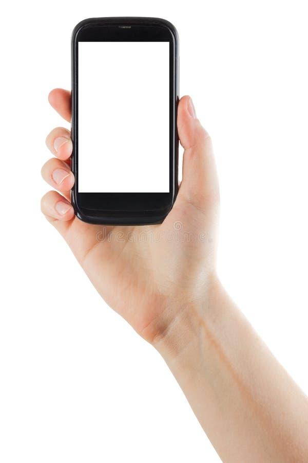 Kvinnliga händer som rymmer mobiltelefonen med den isolerade skärm- och mellanrumsaffärskreditkorten som isoleras på vit bakgrund royaltyfria foton
