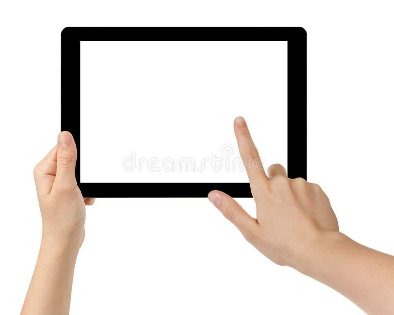 Kvinnliga tonåriga händer genom att använda minnestavlaPC med den vita skärmen arkivfoton