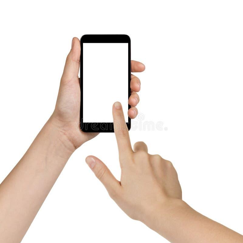 Kvinnliga tonåriga händer genom att använda mobiltelefonen med den vita skärmen royaltyfri foto