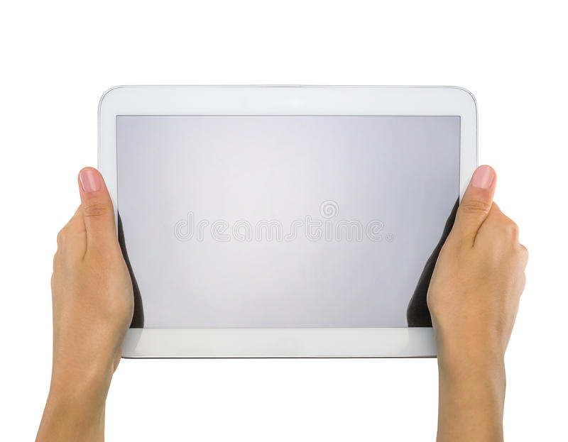 Kvinnliga tonåriga händer som rymmer generisk minnestavlaPC arkivbild