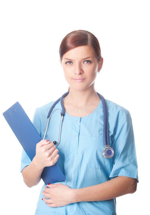 Kvinnligdoktor med medicinska rapporter royaltyfria foton