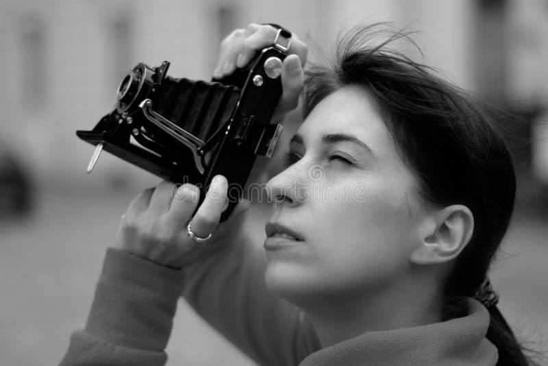 kvinnligfotograf royaltyfria foton