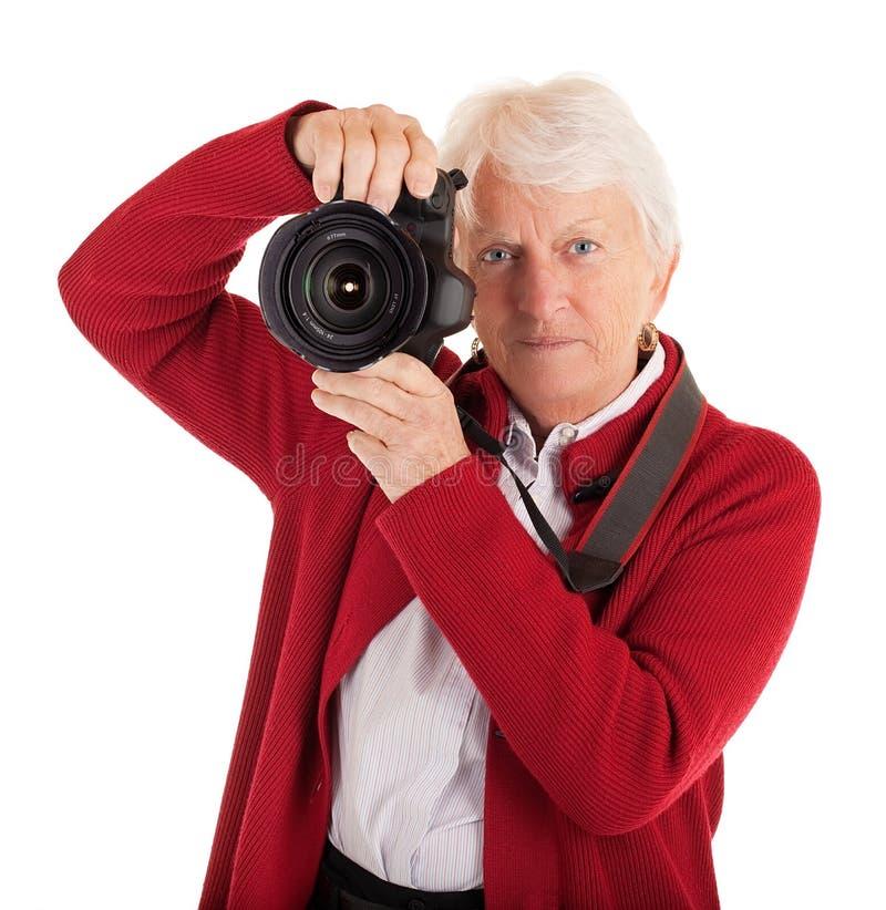 kvinnligfotografpensionär royaltyfria bilder