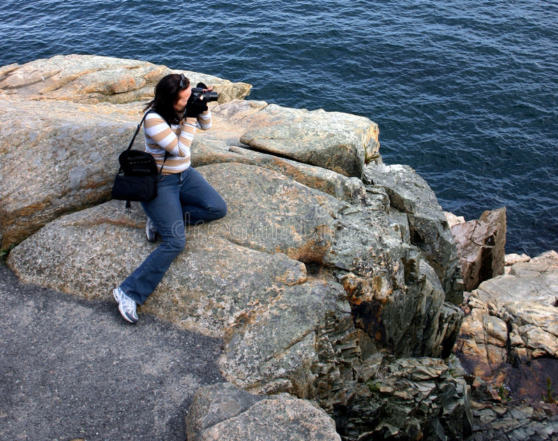kvinnligfotografprofessionell arkivbild