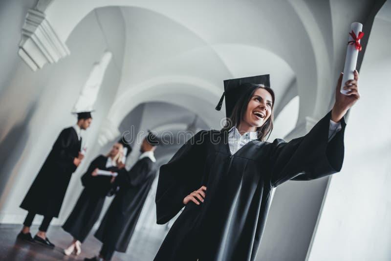 Kvinnligkandidat i universitet arkivfoton