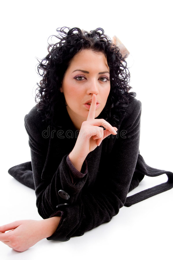 kvinnligkeep som visar det shushing tecknet royaltyfria foton