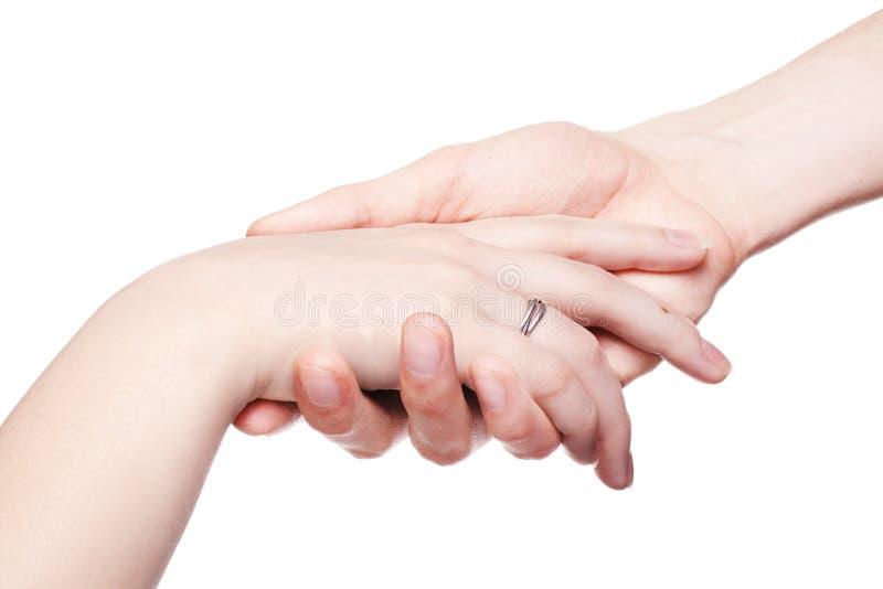 kvinnlign hand försiktigt rymmer mannen royaltyfri foto