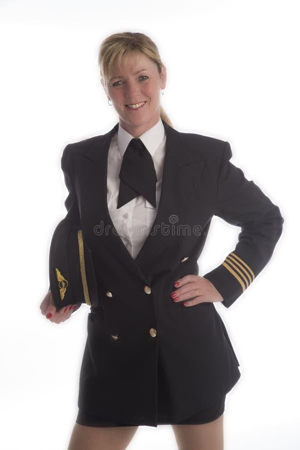Kvinnligpilot i likformig fotografering för bildbyråer