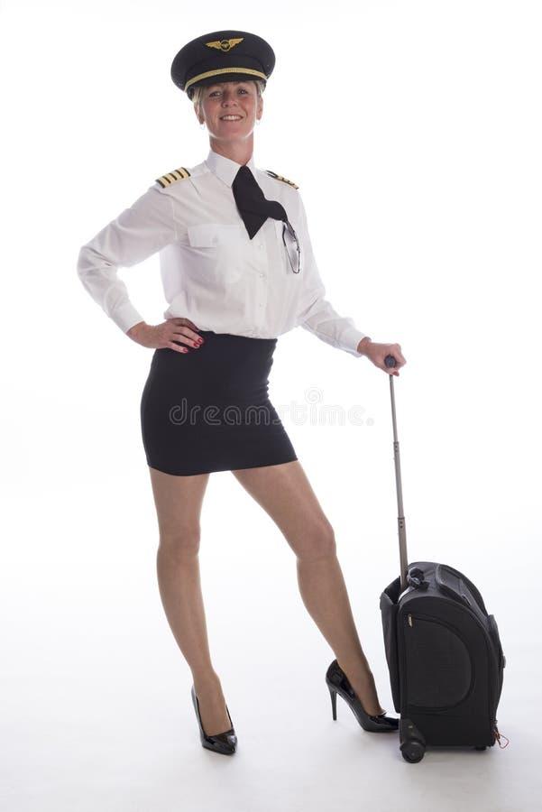 Kvinnligpilot i likformig royaltyfria bilder