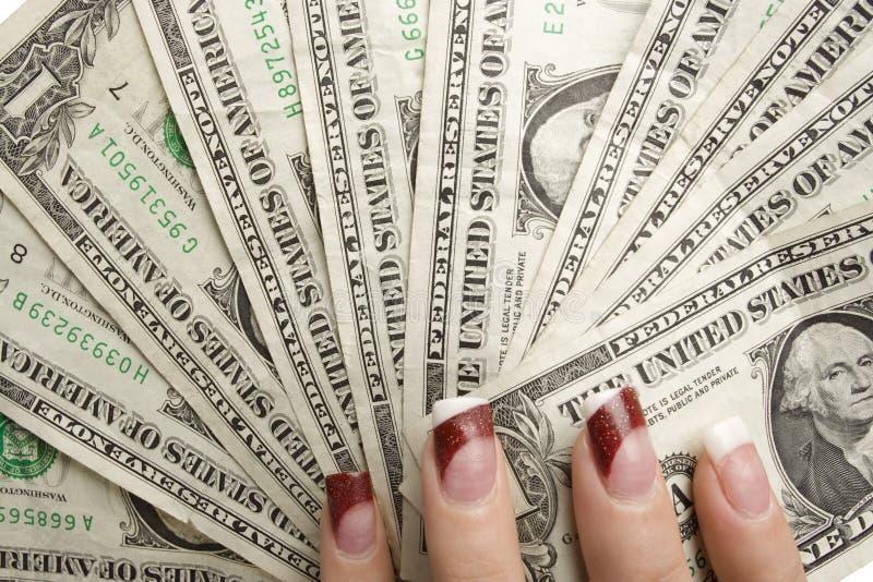 Kvinnligt räcker hållande pengar royaltyfria foton