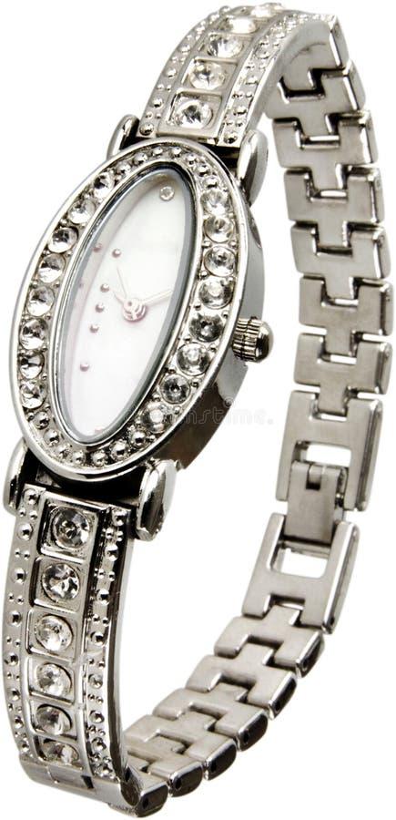 Kvinnligt silverarmbandsur med diamanter som isoleras royaltyfria foton