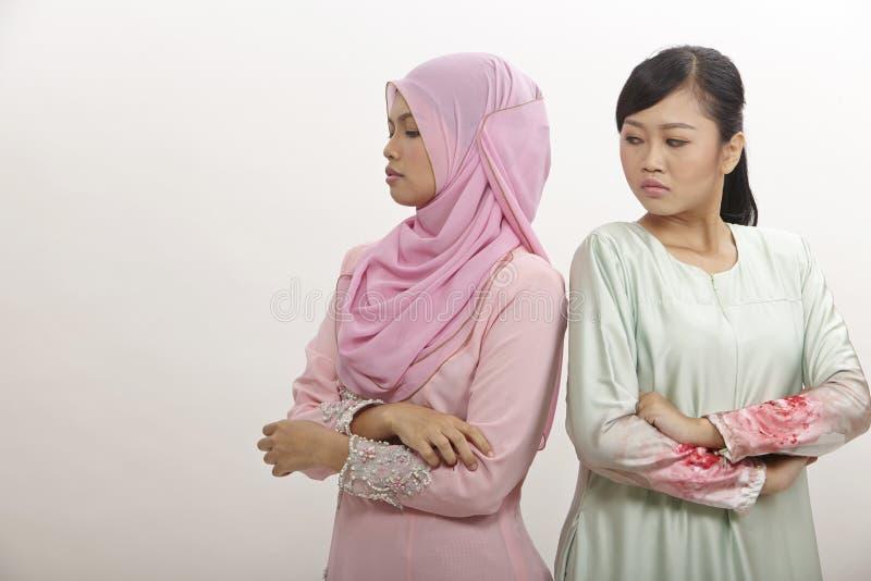 Kvinnor med argument royaltyfria bilder