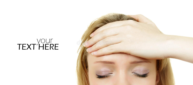 Kvinnor med huvudvärk royaltyfria foton