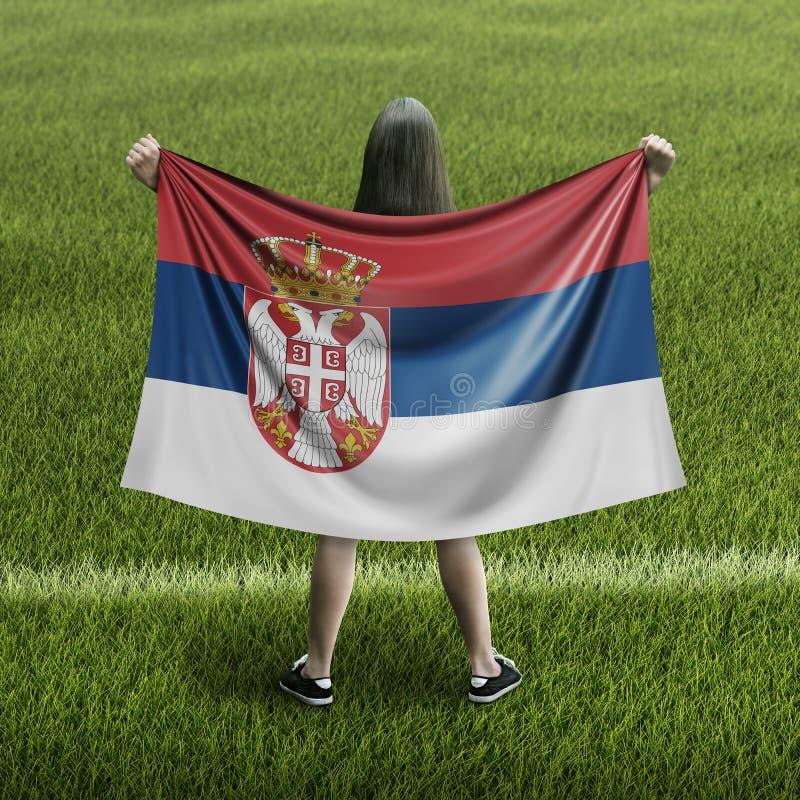 Kvinnor och serbisk flagga fotografering för bildbyråer