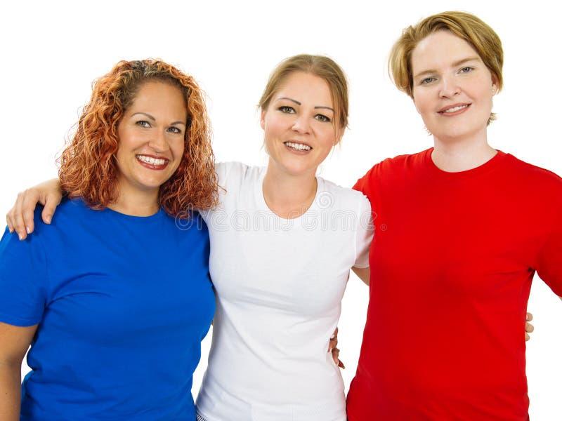 Kvinnor som bär blå vit och röda tomma skjortor fotografering för bildbyråer