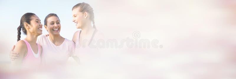 Kvinnor som bär rosa färger för bröstcancer royaltyfria foton