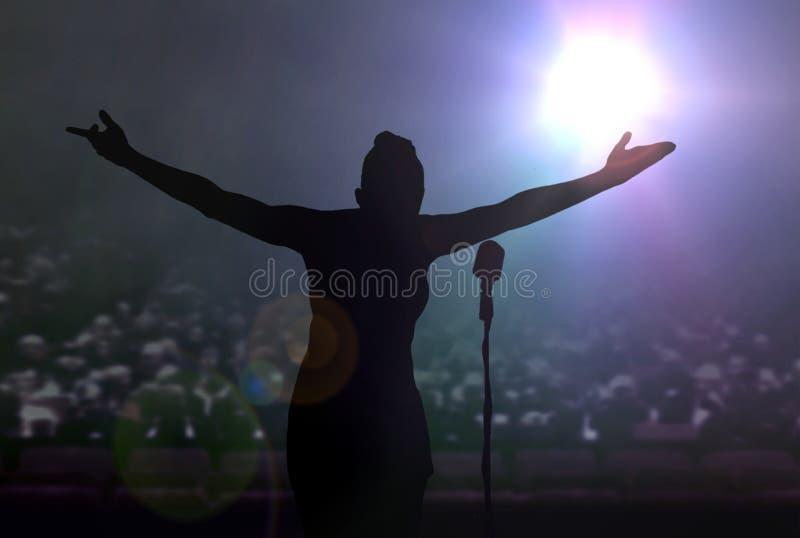 Kvinnor som bugar på etapp efter en konsert fotografering för bildbyråer