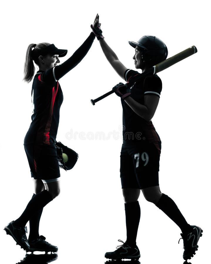 Kvinnor som spelar den isolerade konturn för softballspelare royaltyfria bilder