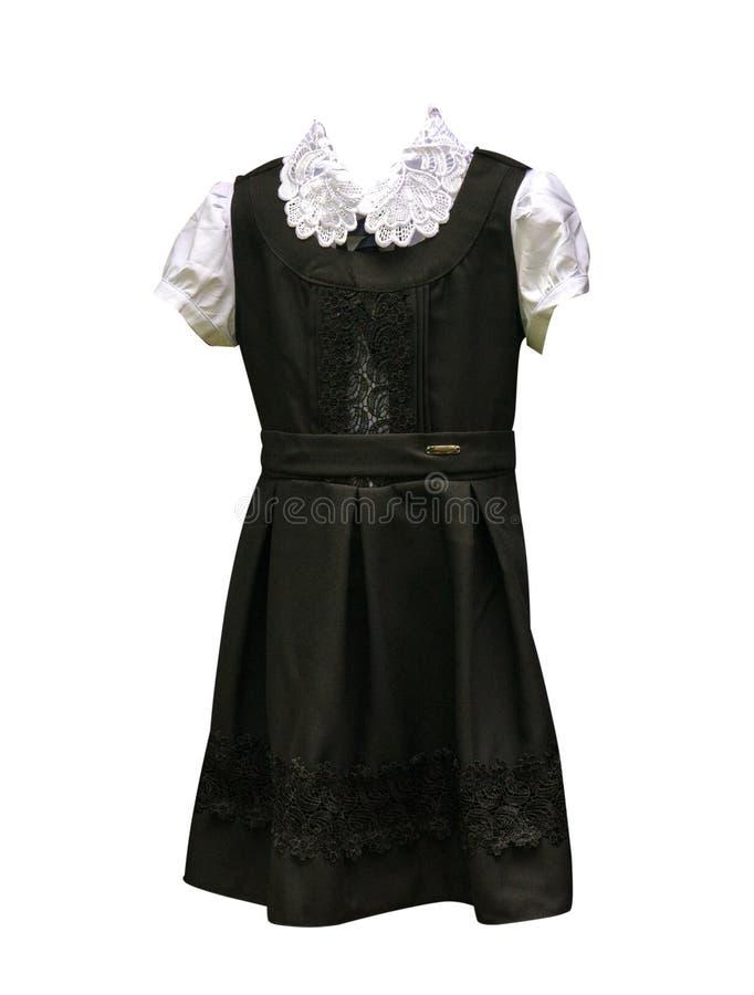 Kvinnors dräkt från en vit blus och en svart klänning kvinnlig klänning isolerad vit bakgrund Skolalikformig royaltyfria bilder