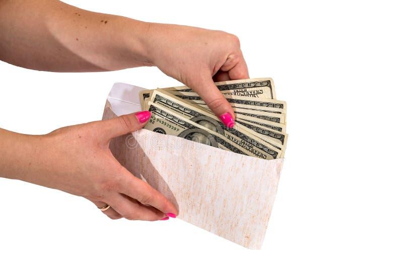 Kvinnors kuvert för handvisning med isolerade dollar arkivfoton