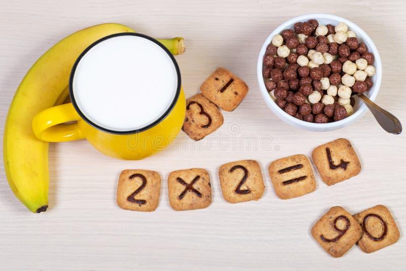 Kwadratowi ciastka z czekoladowymi liczebnikami na one odizolowywamy na bielu fotografia stock