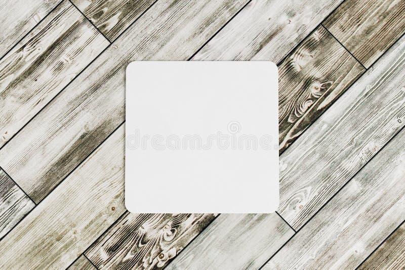Kwadratowy kabotażowiec na drewnianym stole fotografia royalty free