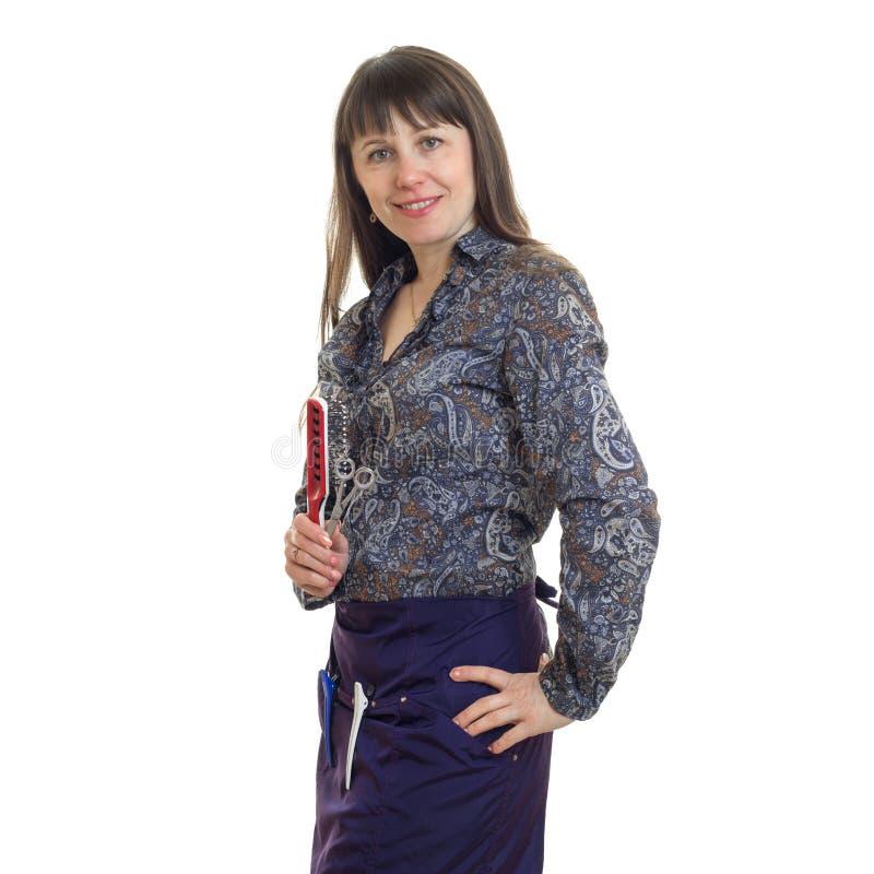 Kwadratowy portret kobieta stylista z narzędziami w rękach ono uśmiecha się na kamerze obraz stock