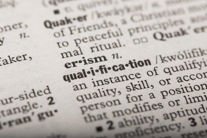 Kwalificatie in een Woordenboek stock foto's