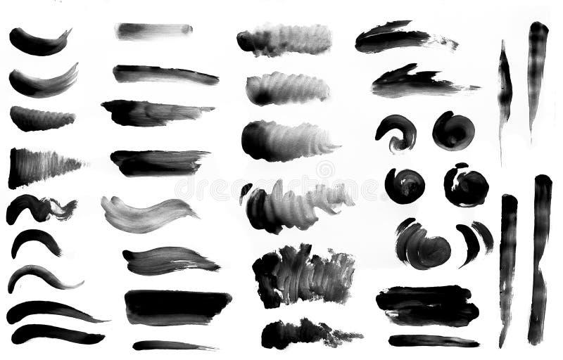 Kwaststreken met waterverfverf op document Kwaststreken met waterverfverf op papier stock afbeeldingen