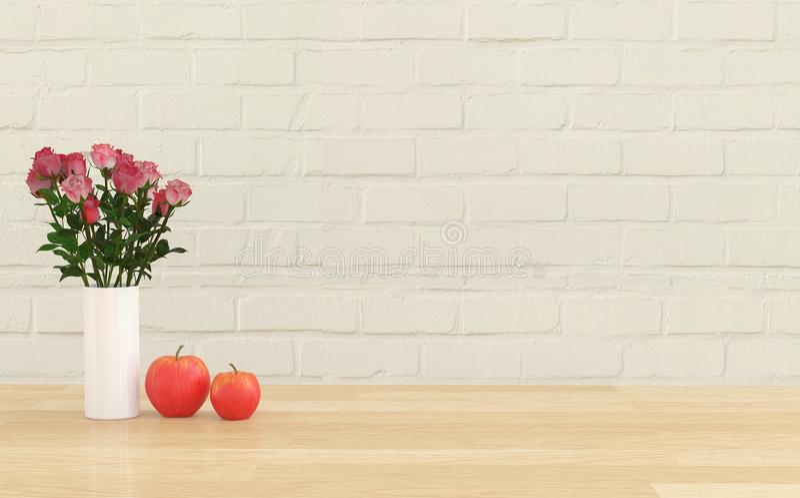 Kwiat w wazie z dwa jabłkami fotografia stock