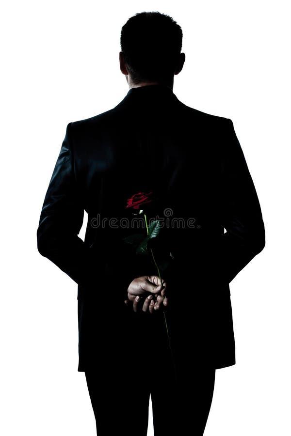 kwiatu mienia mężczyzna portreta róży sylwetka zdjęcie royalty free