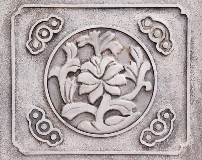 Kwiaty Grawerujący Kamień Zdjęcia Stock