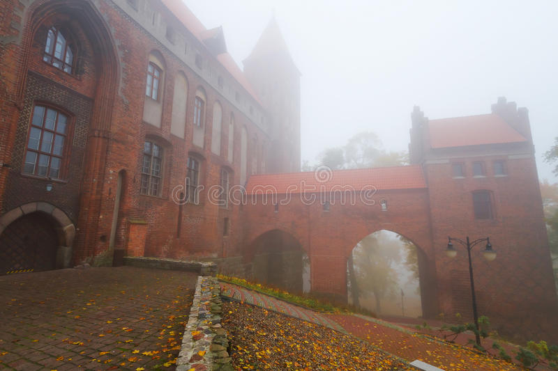 Kwidzyn castle and cathedral in foggy weather royalty free stock photography