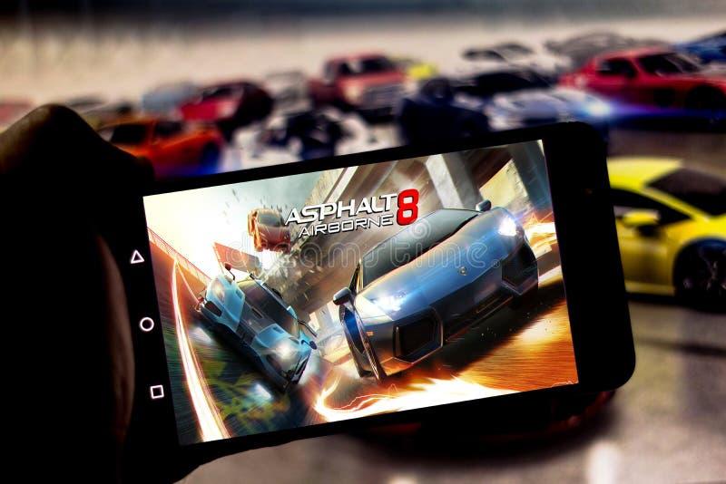Kwiecień 1, 2019, Brazylia Gra asfalt 8: Powietrzny na ekranie urządzenie przenośne Asfalt jest elektronicznym bieżnym grze, zdjęcia royalty free