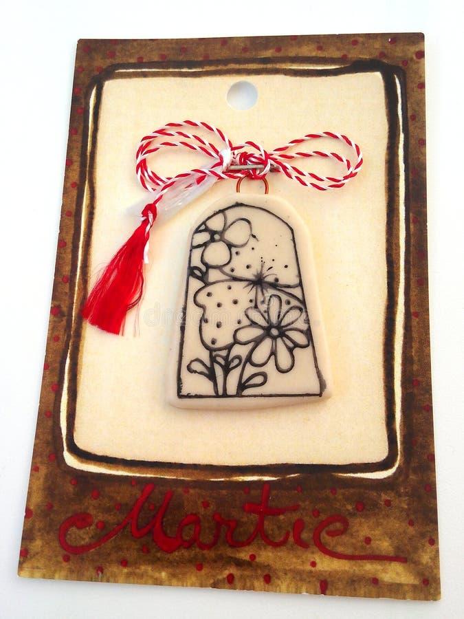 Kwiecisty medalion z czerwonym i białym sznurkiem fotografia stock