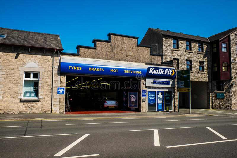 The Kwik Fit garage in Kendal Cumbria UK royalty free stock photography