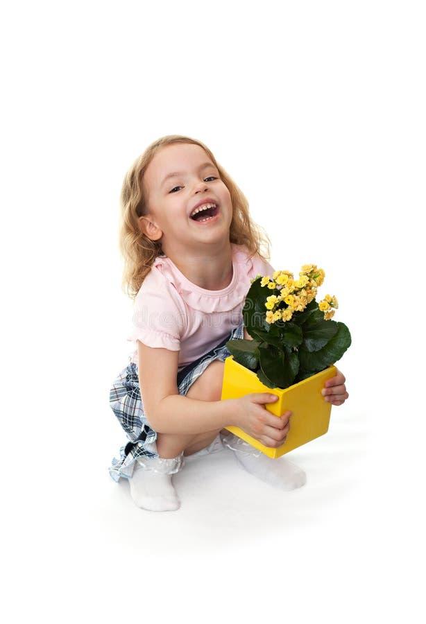 kwitnie dziewczyny kolor żółty radosnego małego fotografia stock
